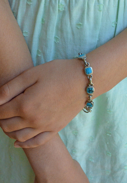 Handcrafted Turquoise and Silver Link Bracelet on Wrist