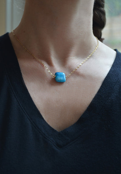 blue stone short gold chain necklace on model