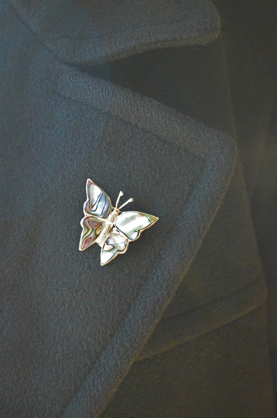 Mother of Pearl and Silver Butterfly Pin on Coat Lapel