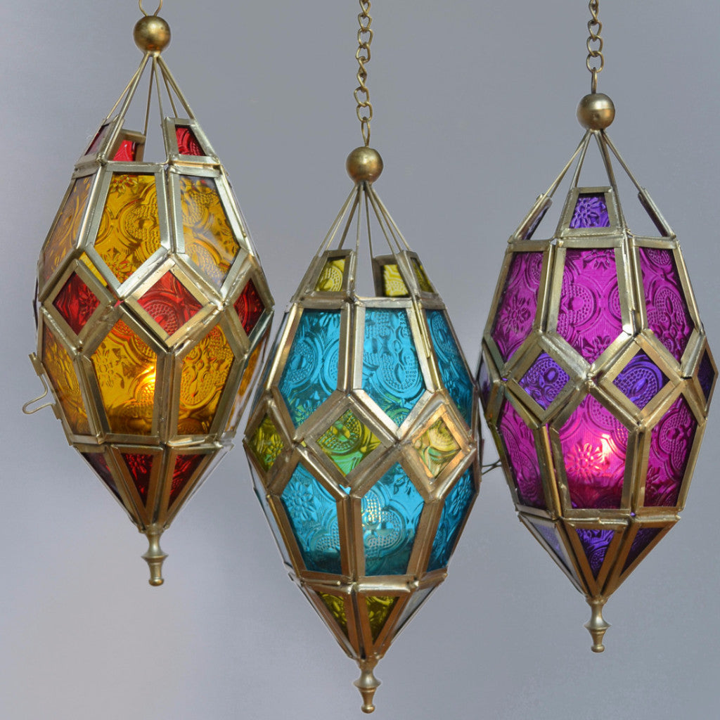 patterned glass hanging lanterns with candles