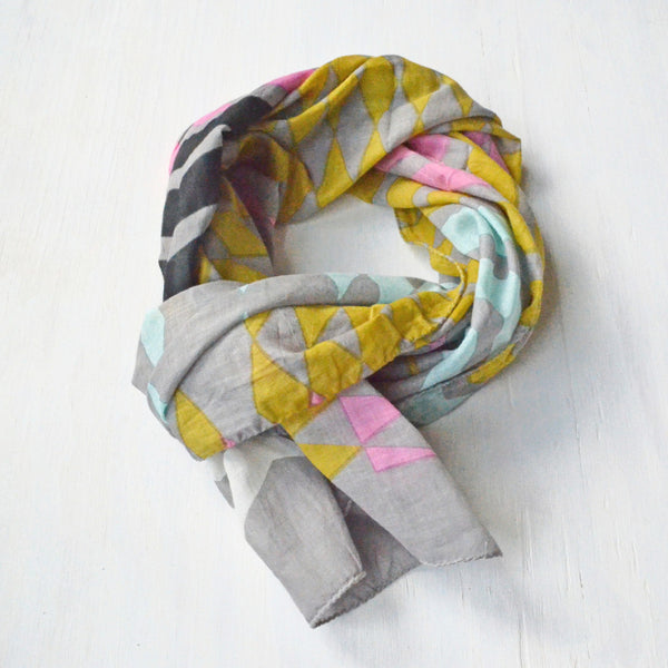 Geometric Print Scarf tied in a circle