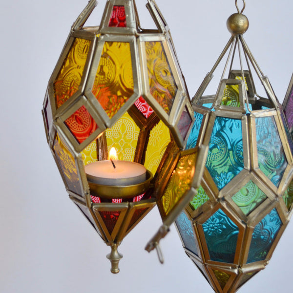 colorful patterned glass hanging lantern, door opened to show candle