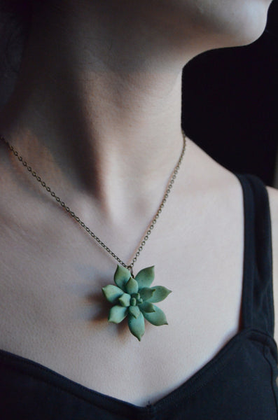 succulent pendant necklace shown on model