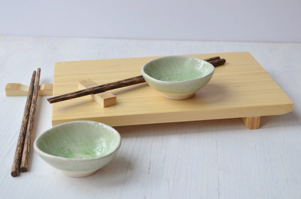sushi gift set with chopsticks, bamboo board and green ceramic dishes