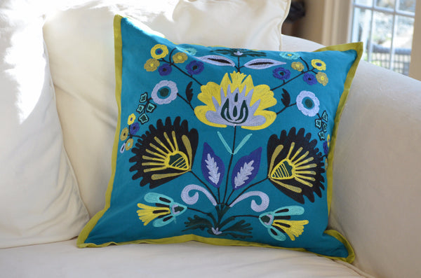 Decorative Pillows | crewel embroidery throw pillow with blue and green on sofa
