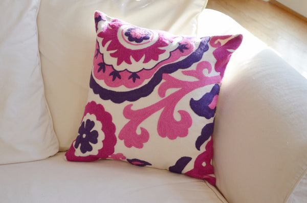 decorative pillows | pink and purple suzani embroidered throw pillow on sofa