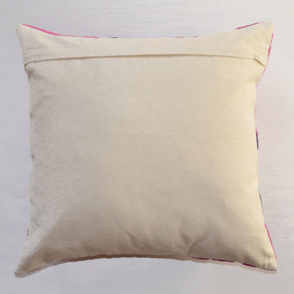 decorative pillows | pink and purple suzani embroidered throw pillow reverse side