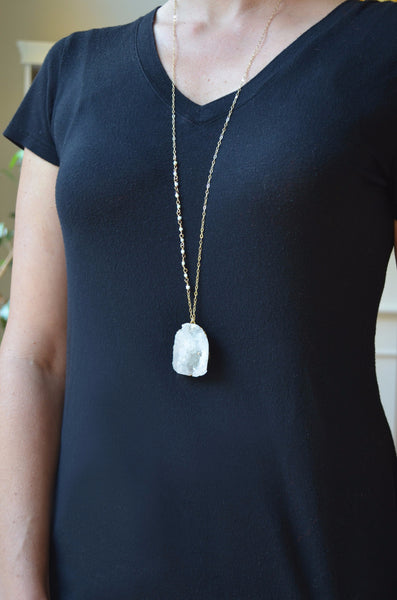 white crystal long pendant necklace on model