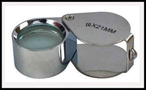 A silver jeweler's loupe, without a case.