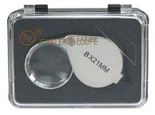 "Load image into Gallery viewer, A silver jeweler's loupe in a black case, with a clear plastic lid. The text ""8X21MM"" is visible in black print on the top of the loupe."