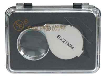 A silver jeweler's loupe in a black case, with a clear plastic lid. The text