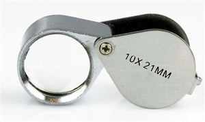 A side view of a silver jeweler's loupe.