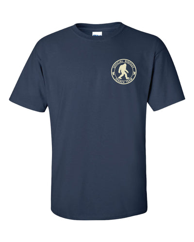 A blue t shirt with a bigfoot logo in the top right corner.