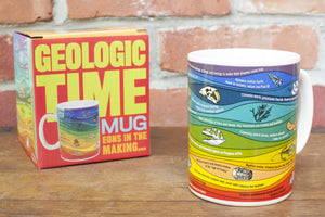A multicolored mug with illustrations of fossils and geologic layers.