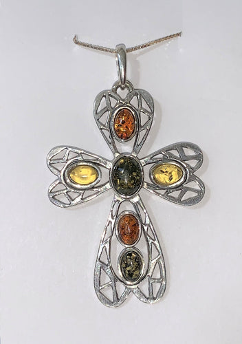 A silver cross inlaid with multiple pieces of different colored amber on a silver chain.