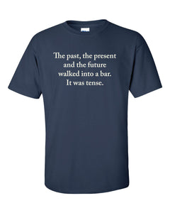 "Dark blue t shirt with white text. ""The past, the present and the future walked into a bar. It was tense."""