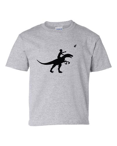 A gray T shirt with a black silhouette of a child riding a dinosaur.