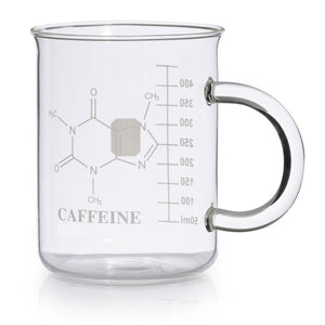 A clear glass mug, empty. Ml markings and the chemical structure of caffeine are visible in white.