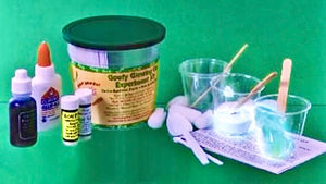 A kit with its contents displayed, including glue, coloring, cups, measuring spoons, and stirring rods.