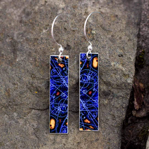 Silver earrings with blue and gold fibonacci like designs.