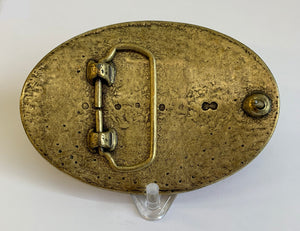 THe underside of a belt buckle, showing the metal clasp.