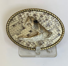 Load image into Gallery viewer, An oval belt buckle with the image of a rattlesnake head.