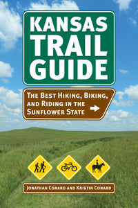 "Cover of ""Kansas Trail Guide: the best hiking, biking, and riding in the sunflower state"". It contains an image of a trail cutting through a field under a blue sky."