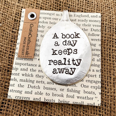 A book a day keeps reality away - Stamped spoon bookmark - Handmade