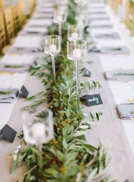 branches lying on table as wedding centerpiece
