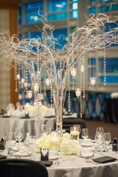 branches centerpiece with candles and crystals