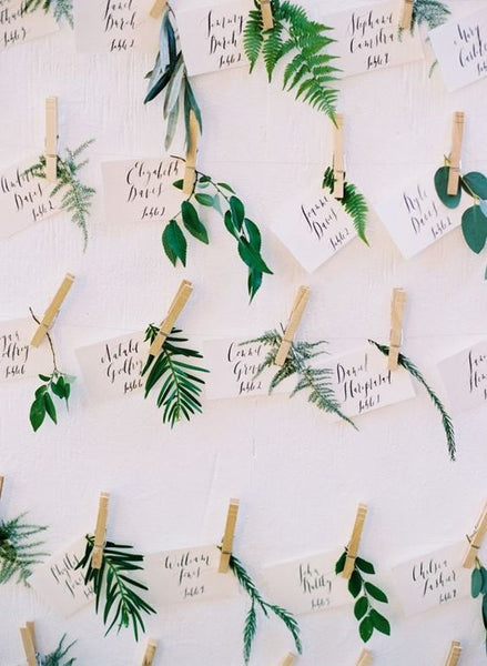 Hanging your escort cards by using strings and clothespin is the rustic way to go.