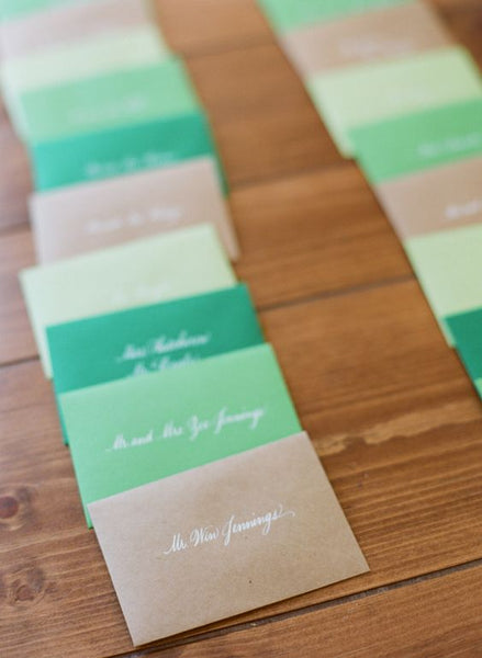 Using envelopes with name tags might just be the easiest way to make escort cards for your wedding.