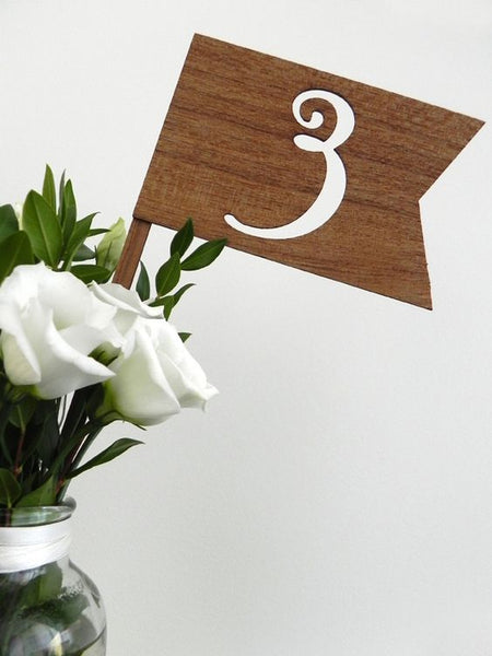 Print out a number, cut it out and put it on a block of wood for a rustic effect.