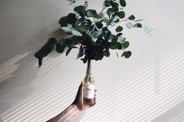 wine bottle with plant centerpiece