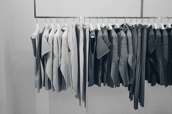 stylish clothes in a closet rack