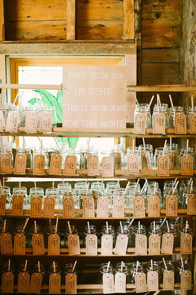 Mason jars with escort cards serve a dual purpose. Aside from letting your guests know where they should be seated, you can also use the jars for their beverage for the night.