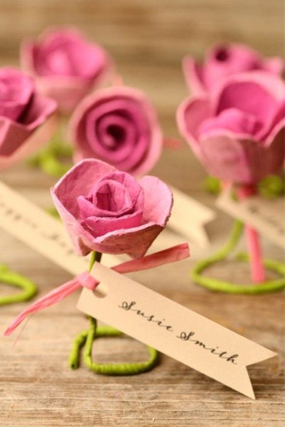 Paper roses are great for just about anything related to wedding decorations. Try them for escort cards.