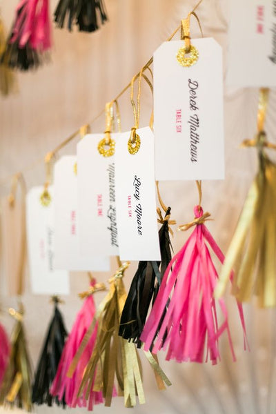 Get your guests in a festive mood with the help of these tassel-decorated escort cards.