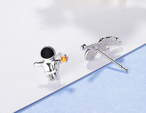 silver universe planet astronaut asymmetric earrings