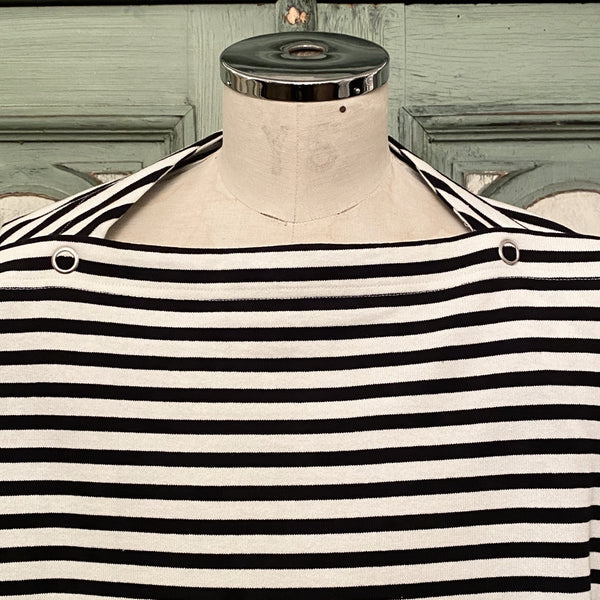 sleeveless shoulder buttoned boat neck shirt.
