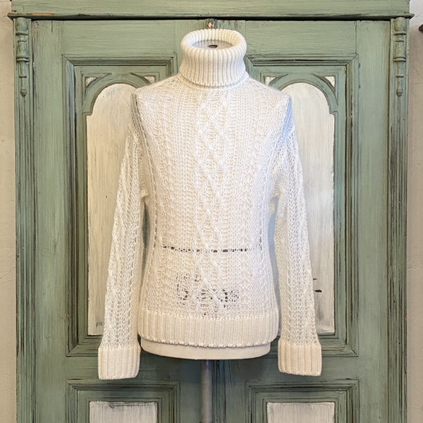 turtleneck aran sweater.