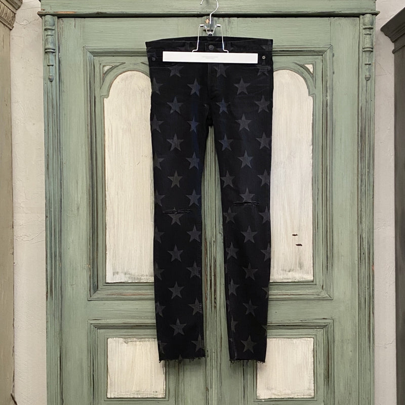 star patterned stretch slim tapered knee slit 6 pocket jean.