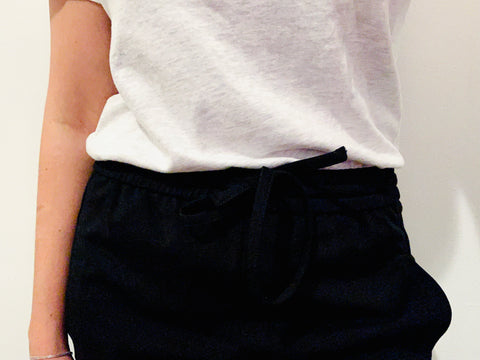 T-shirt tucked in. Style a long T-shirt