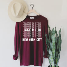 Load image into Gallery viewer, Take Me to NYC | White Letters | Display View | Bodeguita NYC Red Long Sleeve | Designs Made with Happiness in NYC