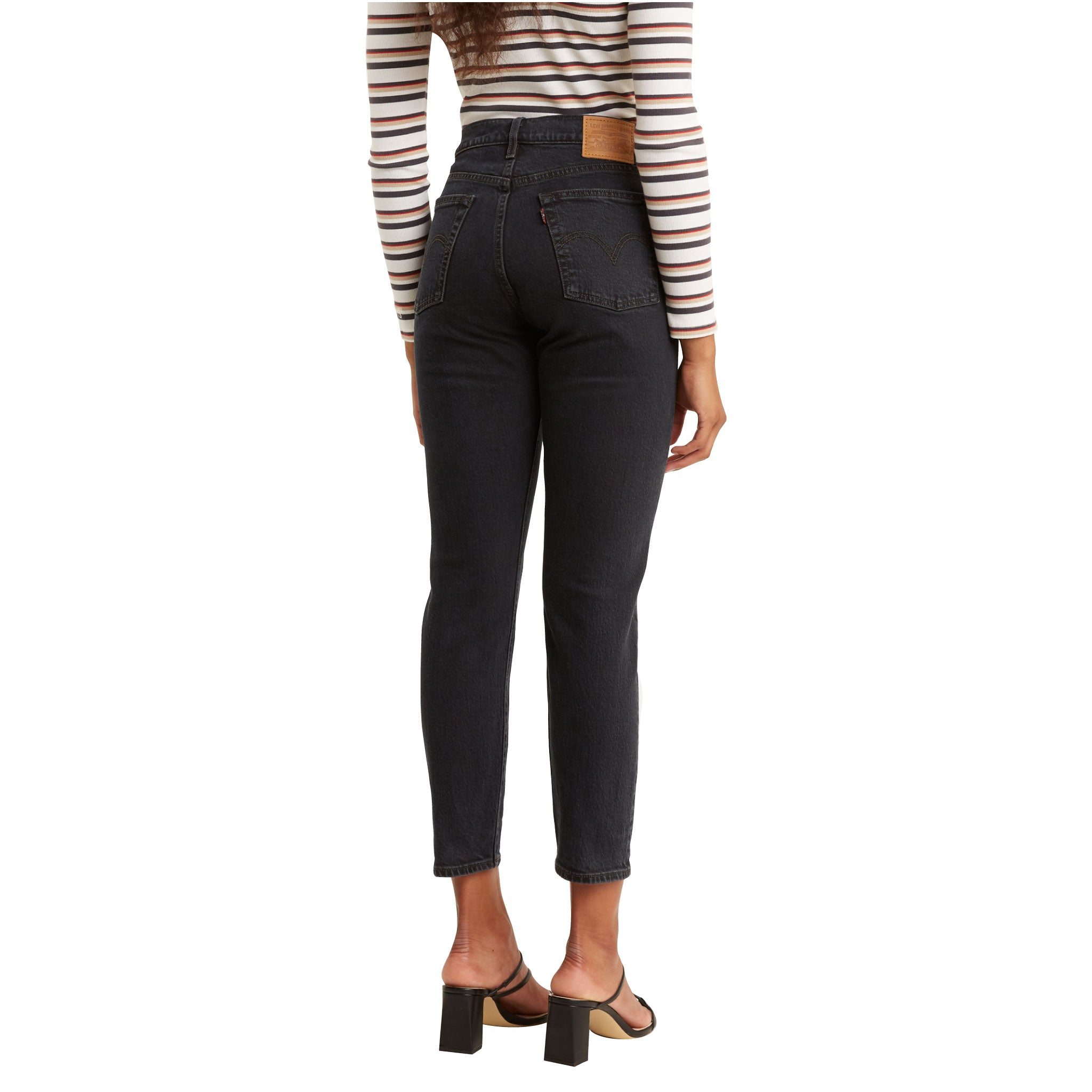 Denim, low stretch  Button fly, 5 - pocket styling  High rise, snug through hip and thigh, straight leg  99% Cotton, 1% Elastane