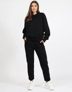 Load image into Gallery viewer, Meet your new Best Friend. Our new style of Crew Neck Sweatshirt is the Best Friend fit. She has a relaxed, slightly slouchy body and sits at your high hip with a waistband that sits close to you. The BF fit has a dropped shoulder and a fuller sleeve with a cuff that fits close to your wrist.     Our Basics collection is 100% cotton and has already been preshrunk so it'll fit you perfectly. We recommend sticking true to size for this collection.