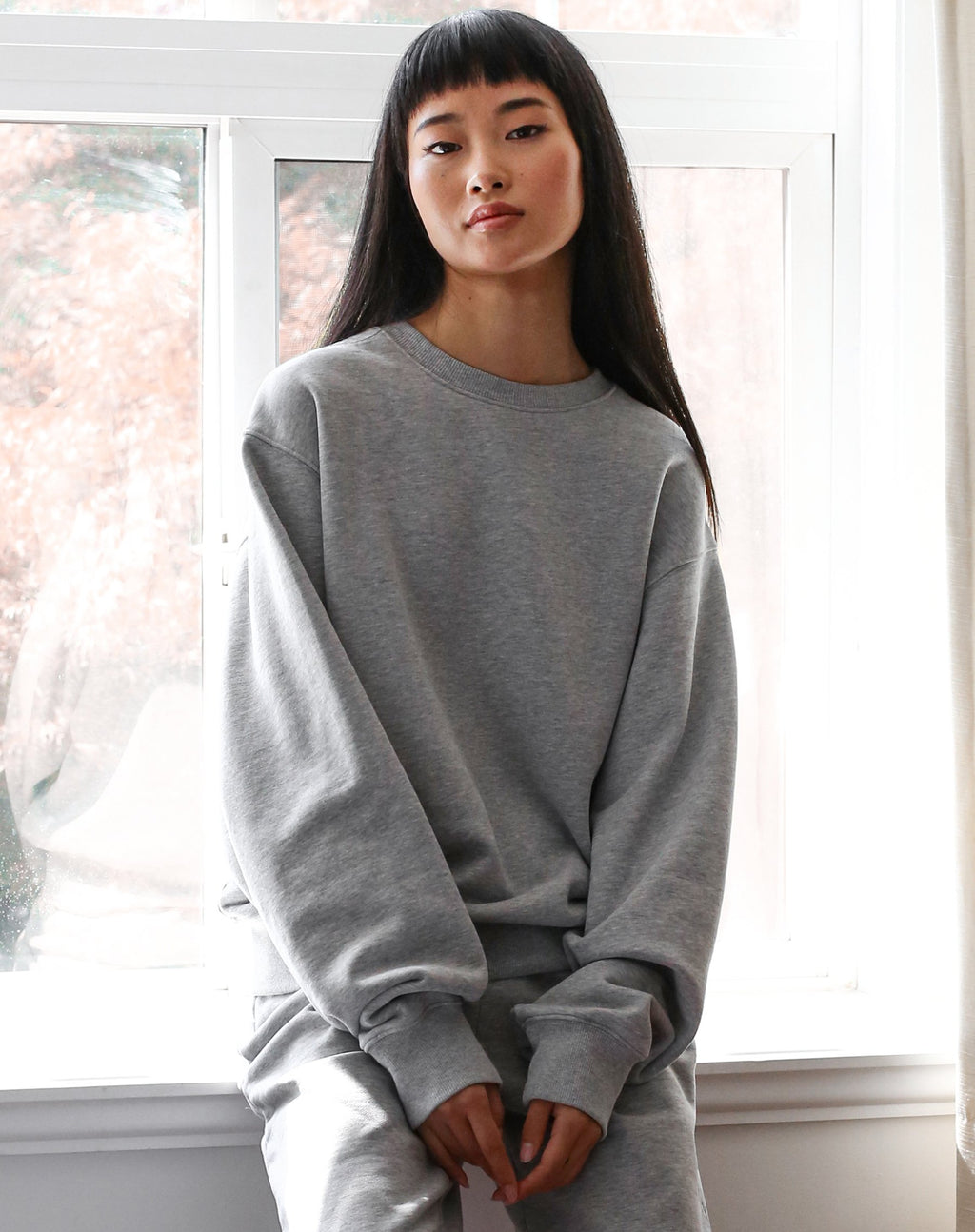 Meet your new Best Friend. Our new style of Crew Neck Sweatshirt is the Best Friend fit. She has a relaxed, slightly slouchy body and sits at your high hip with a waistband that sits close to you. The BF fit has a dropped shoulder and a fuller sleeve with a cuff that fits close to your wrist.     Our Basics collection is 100% cotton and has already been preshrunk so it'll fit you perfectly. We recommend sticking true to size for this collection.