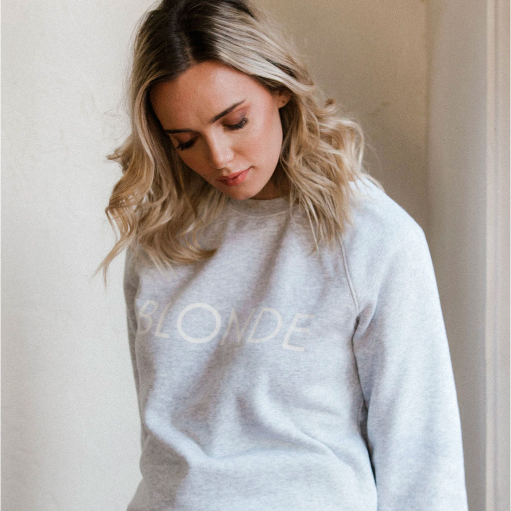 "This cozy crew neck is perfect to rock for your casual days Features a graphic ""Blonde"" on the chest and elastic band cuffs and hem"