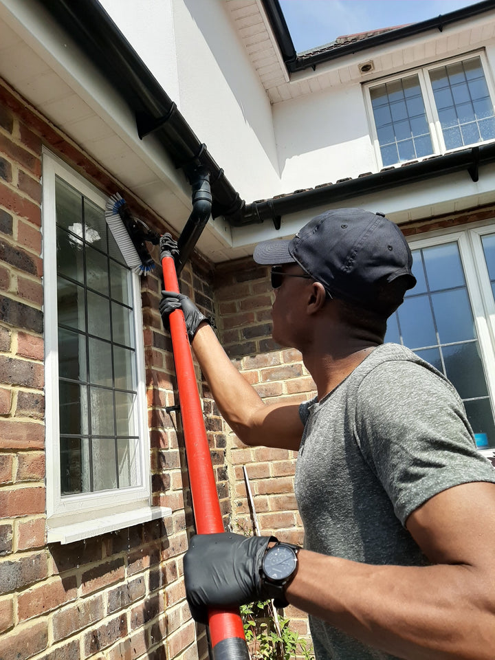 Commercial window cleaning using reach and wash system