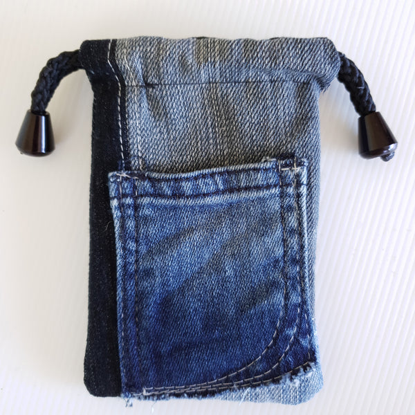 'ITTY BITTY' bags love to protect your Itty Bitty Treasures.  Reversible, One of a Kind, Sustainable, Long Lasting & has a Pocket! Ticks all of our boxes. Sustainably Made ~ Fully Reversible ~ One of a Kind.   Easily fits business cards, crystals, menstrual cup, coins...  It's the bag you need for all your ITTY BITTY necessities. The bag for your bag. Made from our own RePurposed Denim Fabric and lined with high quality cotton featuring our folksy screen printing.  Super Sweet Size - 15cm x 8.5cm
